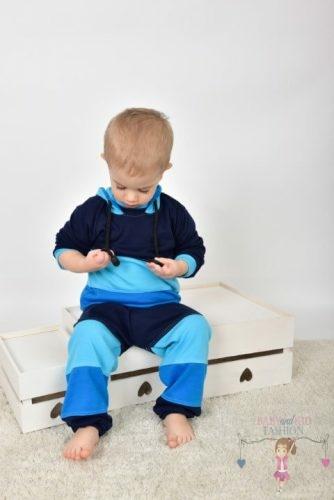 A babyandkidfashion egy egyedi bababolt, ahol egyedi stílusú kis ruhákat találsz. Kisgyermek az egyedileg készített szettben, kép.